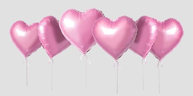 Bündel von herzformfolienballons der rosa farbe lokalisiert auf hellem hintergrund