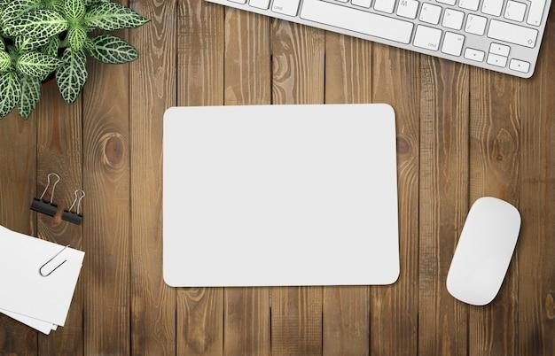 Büromodell, weiße matte auf dem schreibtisch