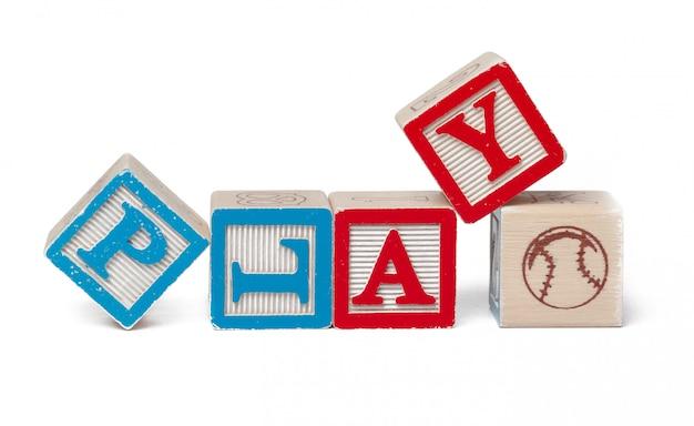 Bunte alphabetblöcke. wortspiel getrennt auf weiß
