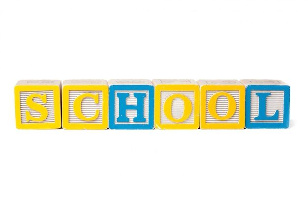 Bunte alphabetblöcke. zurück zu der schule lokalisiert