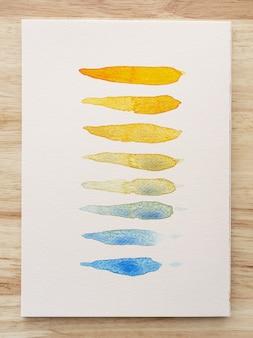 Bunte aquarellflecken auf weißem papier. satz aquarellpinselstreifen. tinte striche. flacher art pinselstrich. nahaufnahme.