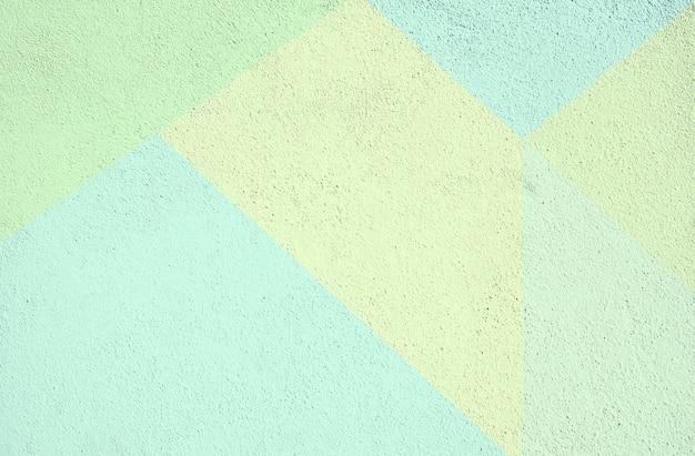 Bunte beton gemalte hintergrundbeschaffenheit. grün gelb