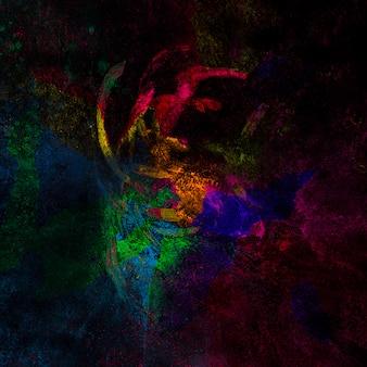 Bunte festivalfarben über dunkle oberfläche verteilt
