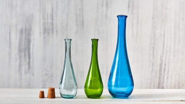 Bunte flaschen als konzept zum speichern von hausgemachten produkten Premium Fotos