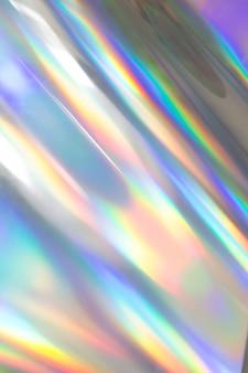 Bunte lebendige holographische pastellfolienhintergrundbeschaffenheit. giftiger rave, partyhintergrund.