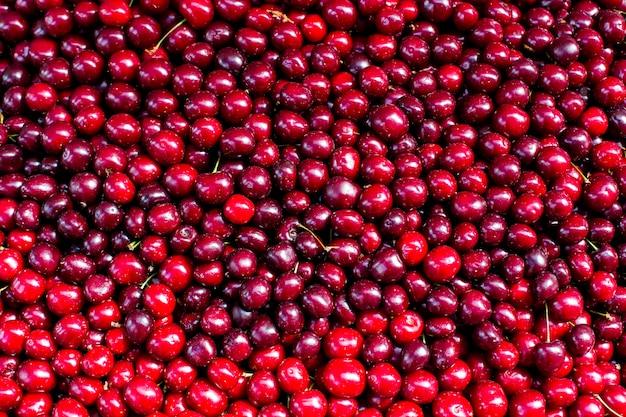 Bunte musterbeschaffenheitshintergrund der frischen roten kirschbeere abstrakte frucht