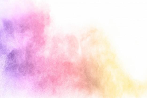 Bunte pulverexplosion. pastellfarbenstaubpartikel spritzen.