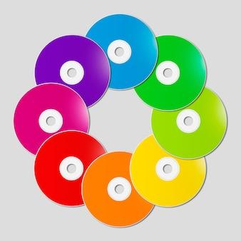 Bunte regenbogen-cd - dvd in einer kreisform auf grauem hintergrund
