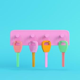 Bunte schlüssel auf schlüsselhalter auf hellblauem hintergrund in pastellfarben. minimalismus-konzept. 3d-rendering