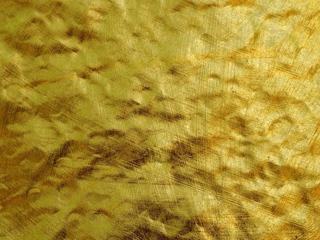 Bunter abstrakter hintergrund der goldfolie.
