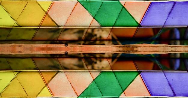 Bunter gelber, rosa, violetter und blauer beschaffenheitszusammenfassungshintergrund