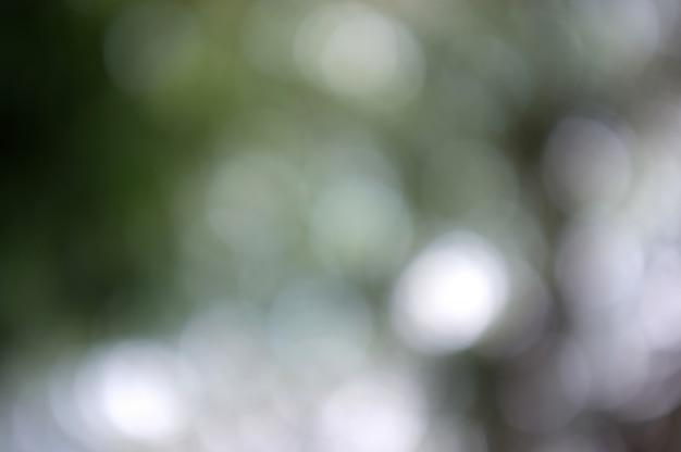 Bunter hintergrund mit natürlicher bokeh beschaffenheit und defocused funkelnden lichtern