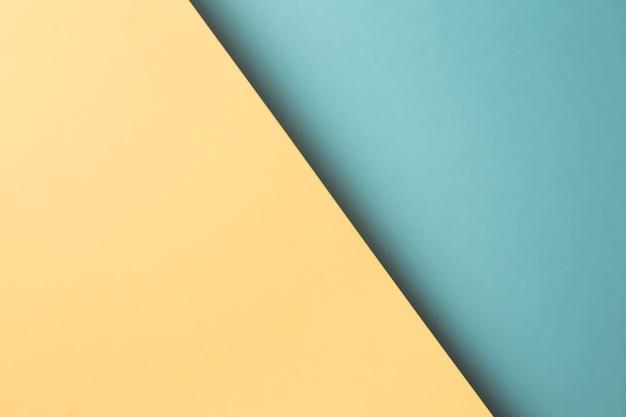 Bunter und minimalistischer hintergrund mit blauen und gelben pastellfarben kopieren raum und modernes design