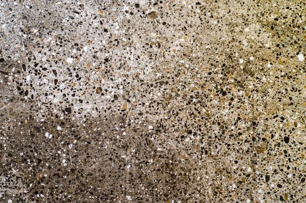 Bunter unordentlicher kleiner steinoberflächenhintergrund.