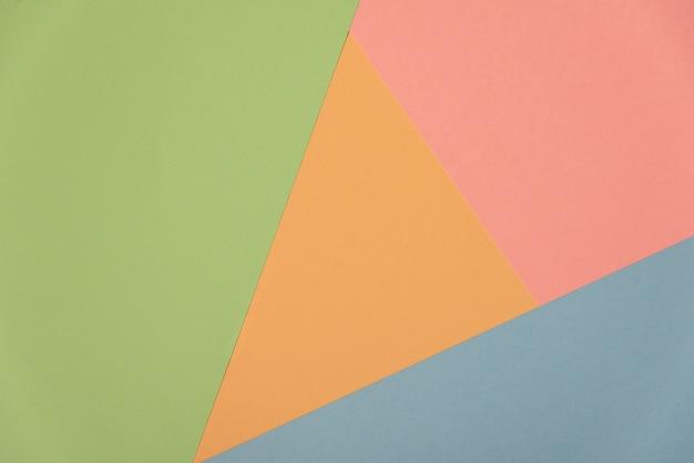 Bunter weicher grüner, orange, cyan-blauer und rosa papierhintergrund.