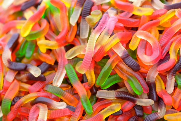 Bunter wurm formte süßigkeiten, süßen hintergrund