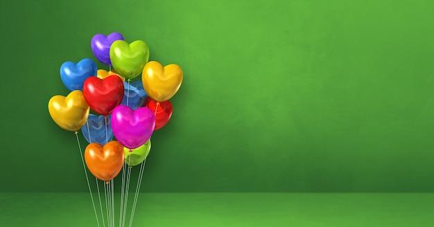 Buntes herzformballonbündel auf einem grünen wandhintergrund. 3d-darstellung rendern