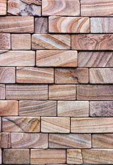 Buntes sandsteinwandsteinsteintexturfliesenhintergrund-patchwork, braun