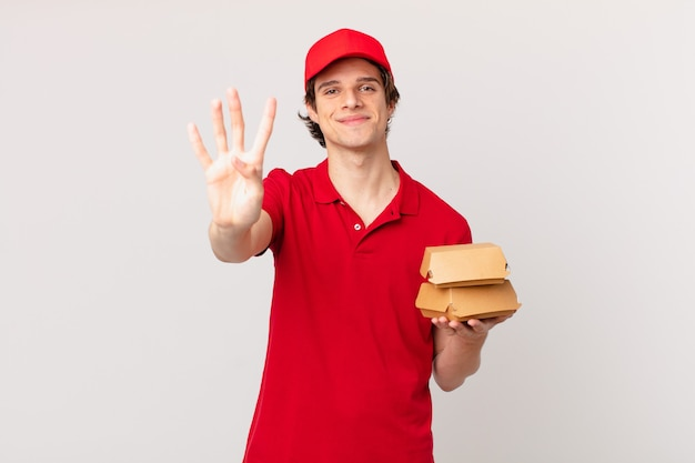 Burger liefern mann lächelnd und freundlich aussehend, nummer vier zeigend