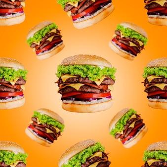 Burger-muster auf orangefarbenem hintergrund