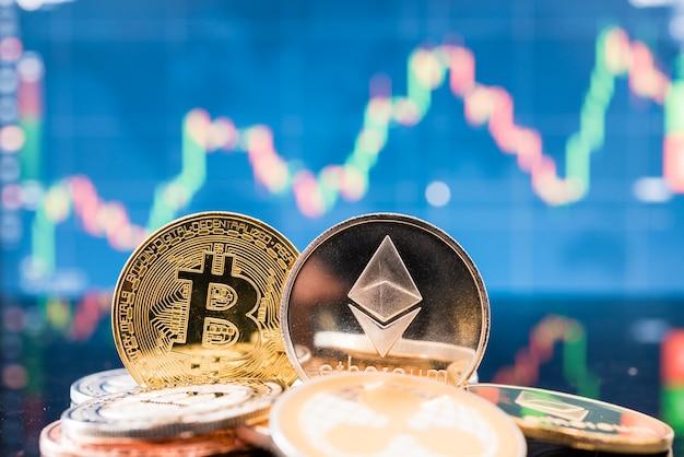 Business bitcoin und ethereum coin finanzieren geld auf grafikdiagramm