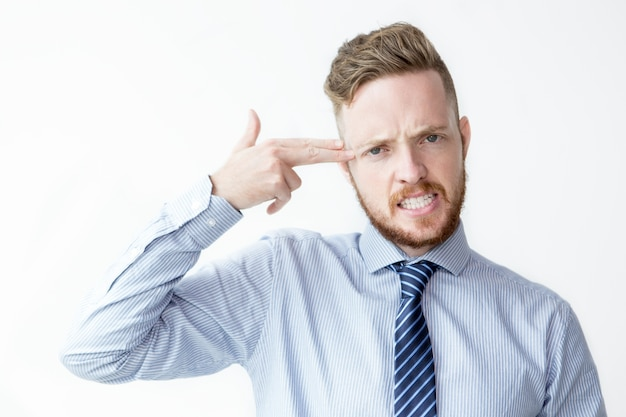 Business man shooting sich mit fingern