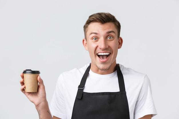 Café- und restaurants-café-besitzer und einzelhandelskonzept begeisterte glückliche, gutaussehende barista-k...
