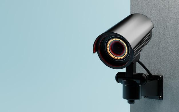 Cctv-überwachungskamera auf blauem hintergrund an der wand isoliert. sichere technologie im immobilien- und hausbesitzerkonzept. platz kopieren. 3d-darstellungs-rendering