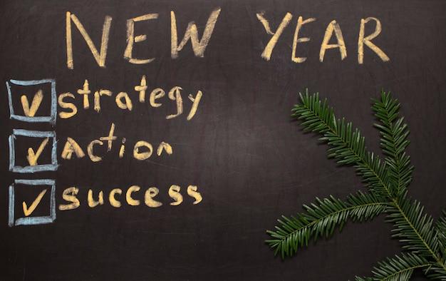 Checkliste für neujahrsvorsätze auf tafelhintergrund
