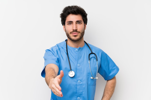 Chirurgdoktor-mannhändeschütteln nach viel