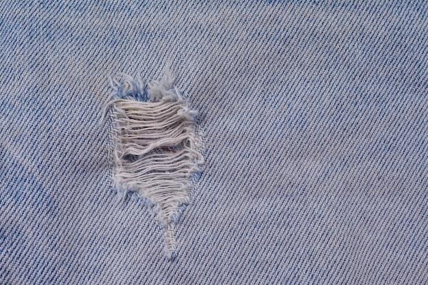 Close up, jeans zerrissenen hintergrund und textur