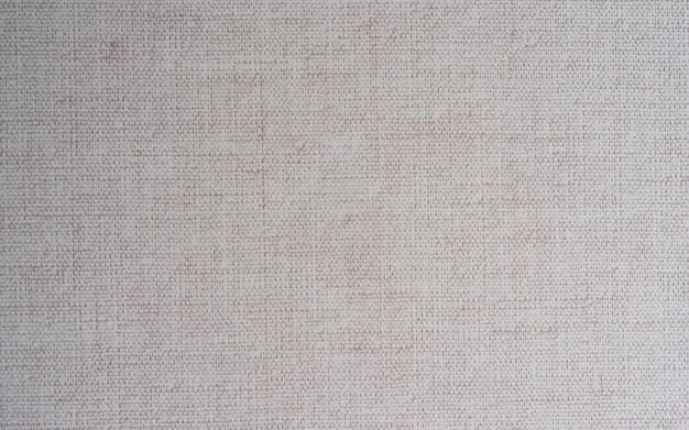 Closeup hellcreme, beige farbe stoff textur teppich