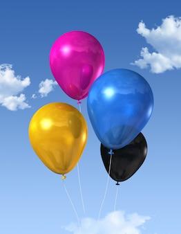 Cmyk farbige primärluftballone, die auf einen blauen himmel schwimmen