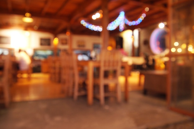Cofee shop licht unscharfen hintergrund bei nacht