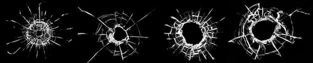 Collage von rissen im glas, ein loch von kugeln im glas auf schwarzem hintergrund. fensterglas textur.