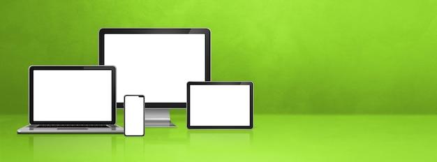 Computer, laptop, handy und digitaler tablet-pc - grünes schreibtischbanner. 3d-illustration