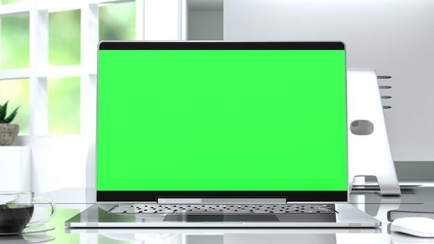 Computer modell mit grünem bildschirm auf schreibtisch 3d-rendering