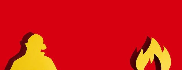 Concept firefighters day - der internationale wichtige tag des feuers, wird in vielen ländern der welt gefeiert. feuer und feuerwehrmann aus papier auf rotem grund. grußkarte platz kopieren