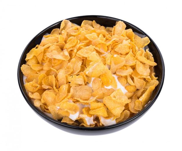 Corn flakes mit der milch getrennt auf weiß