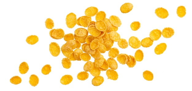 Corn flakes, traditionelles frühstückskost aus getreide lokalisiert auf weißem hintergrund