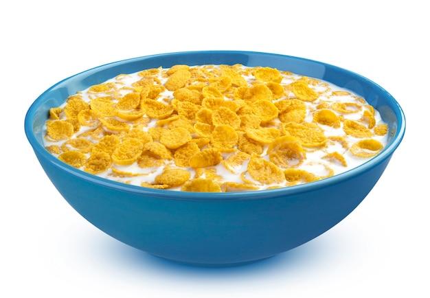 Cornflakes mit milch in blauer schüssel