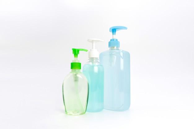 Coronavirus (covid-19) schutz blau und grün gel desinfektionsset, isoliert.