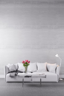 Couch in weiß an der betonmauer