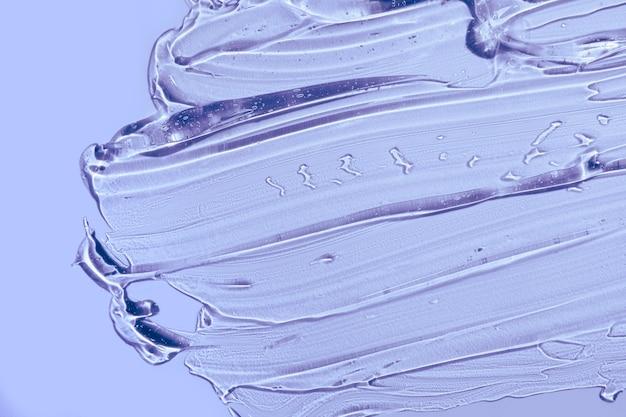 Creme gel lila transparente kosmetische probe textur wisch hintergrund