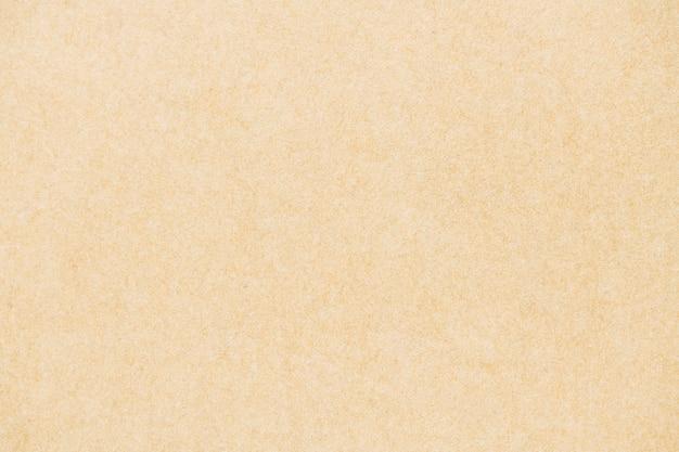 Creme glatter strukturierter papierhintergrund