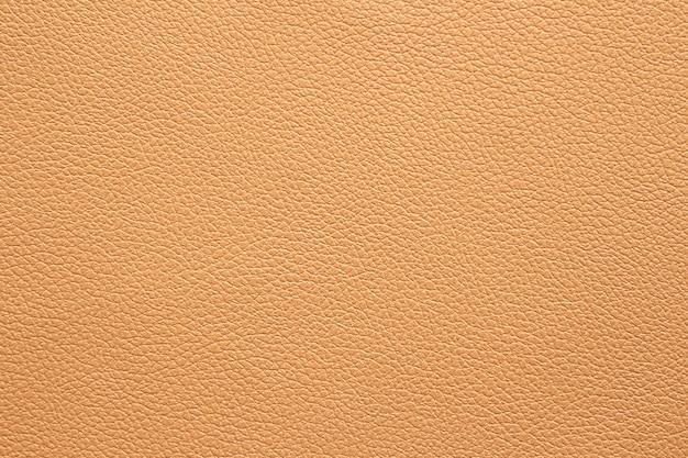 Cremefarbener oder brauner hintergrund aus ledertextur