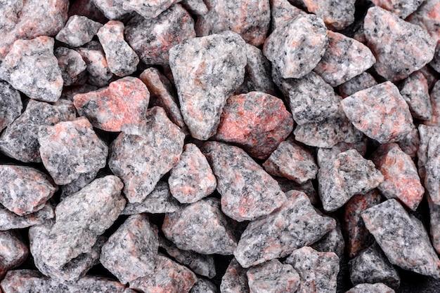 Crushed stone abstrakten strukturierten hintergrund. baustoffhintergrund