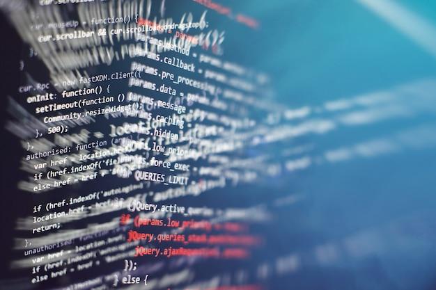 Css-, javascript- und html-nutzung. überwachen sie die nahaufnahme des funktionsquellcodes. abstrakter it-technologiehintergrund. quellcode der software.