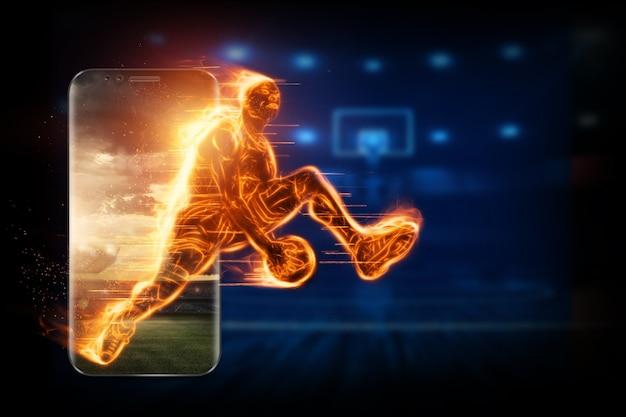 Das feurige bild eines basketballspielers schneidet aus seinem smartphone. kreative collage, sport-app. konzept für online-shop, online-anwendung, sportwetten, 3d-darstellung, 3d-rendering