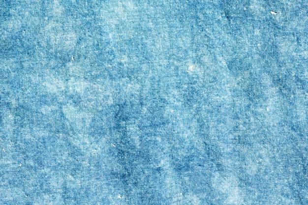 Das gewebe ist indigofärbung, lokales gewebe, indigo-bindungsfarbstoffmuster auf baumwollgewebe-zusammenfassungshintergrund.